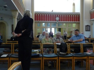Composer Margaret Lucy Wilkins talking to the audience at St Botolph's